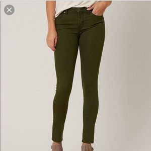 Just black distressed green jeans